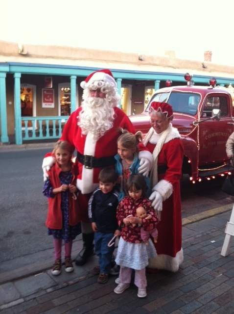 Santa and Mrs Claus outside The Shop