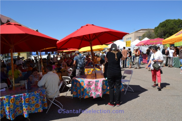 Food booths and shade umbrellas provide a welcoming refueling station.