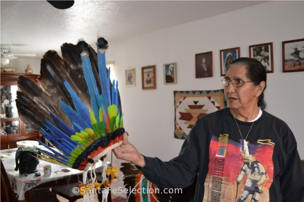 Andy Garcia showing a ceremonial feather head dress.