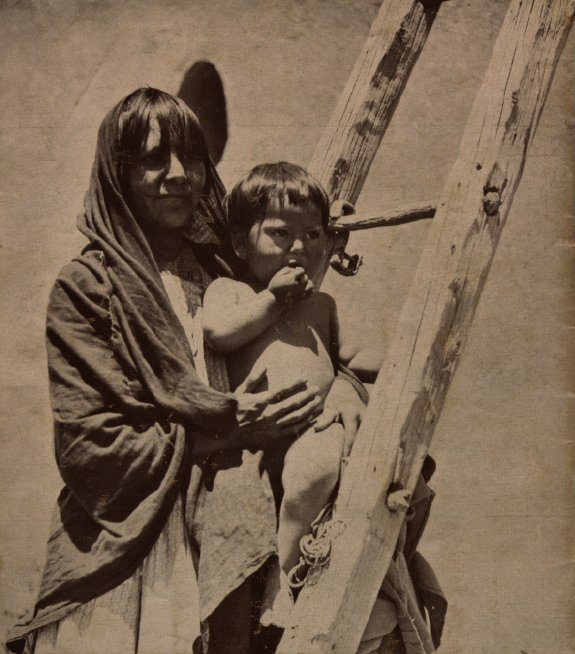Image of Pueblo woman and child. Harvey Indian Detours brochure.