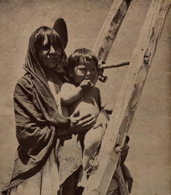 Image of Pueblo woman and child. Harvey Indian Detours brochure.