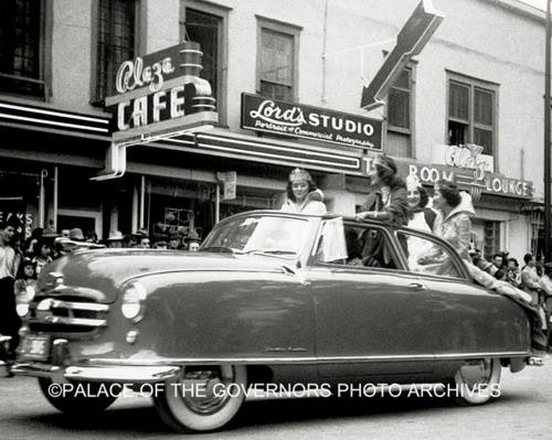 Plaza Cafe as the Fiesta Queen drives by, circa 1957. Courtesy of Palace of the Governors Photo Archives.