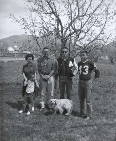 Anna Marie, youngest son Stephen, Allan, Bob, Phillip and dog Bully. 1962. Houser family archive.