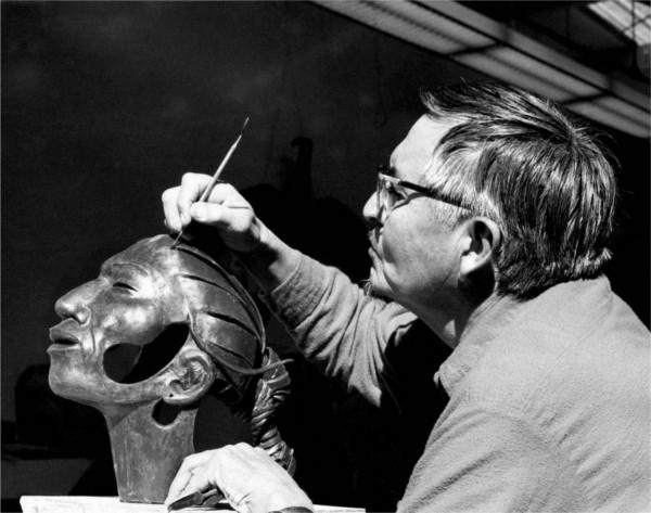 Allan Houser working on a bronze sculpture.