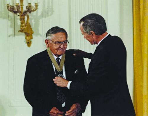Receiving Medal of Art from President Bush.