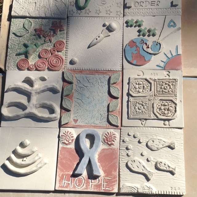 Santa Fe Clay Play-Tile work by a group.
