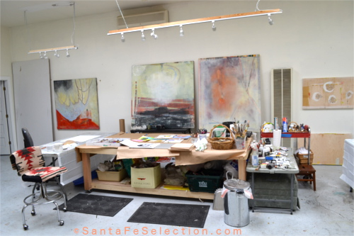 Lauren Mantecon studio with hanging mixed media works.