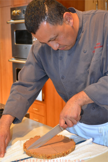 Chef Cano slicing the Spicy Mexican Chocolate Sauce.