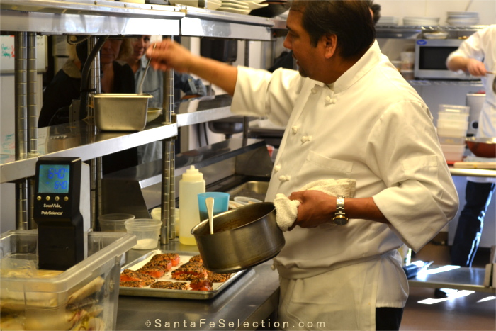 Chef Martin Rios preparing Salmon dishes for the group.