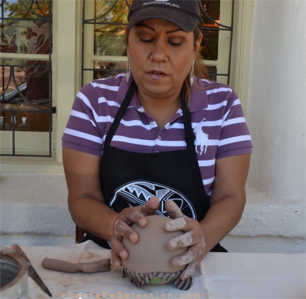 Dominique Toya of Jemez Pueblo demonstrating the creation of a Seed Pot at Lyn A. Fox Gallery, Canyon Road.