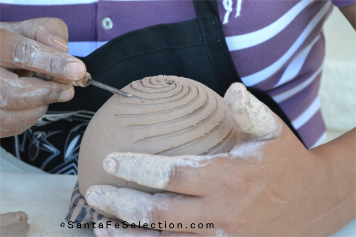 Dominique Toya - Jemez Pueblo. Carving in the decoration to the seed pot.