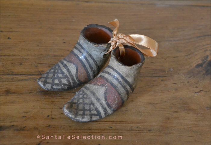 Rare pair of tiny boots from Isleta Pueblo. Sold as souvenirs at train station circa 1910.