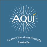 aqui luxury vacation rentals logo